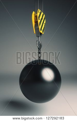 Crane hook with wrecking ball on dark grey backgound. 3D Rendering