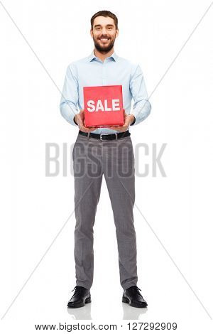 people, shopping, discount and holidays concept - smiling man holding red sale sign