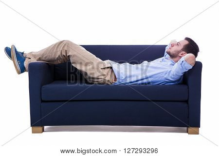 Handsome Man Lying On Sofa Isolated On White