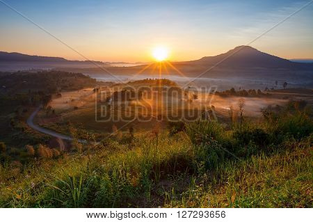 Misty Morning Sunrise And House In Khao Takhian Ngo View Point At Khao-kho Phetchabun,thailand..