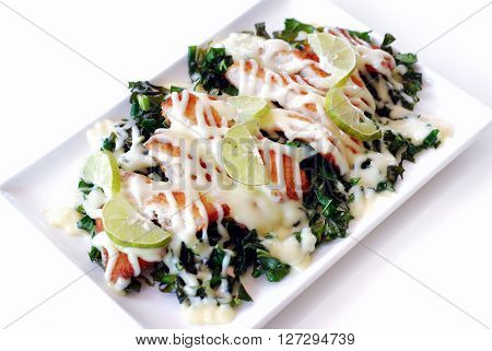 Selective focus of crispy fry chicken with lemon mayonnaise and Chinese kale on white background