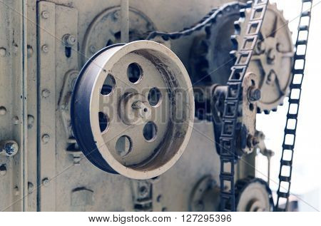 agriculture, manufacture, industry and farming concept - vintage machine mechanism at factory