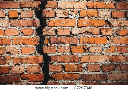 A brick wall with a crack red brick. A brick wall with a crack red brick