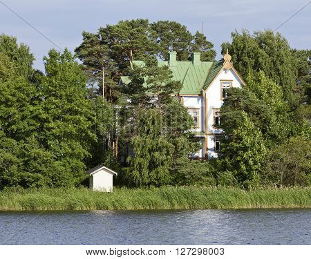 OSTERBOTTEN, POHJANMAA, FINLAND ON JULY 04. View of modern buildings, homes on the seaside on July 04, 2013 in Pohjanmaa, Finland. Coastal are of the Baltic Sea up North. Editorial use.