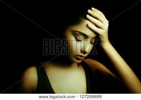 Depression Concept. Sad Young Woman with Face in the Dark