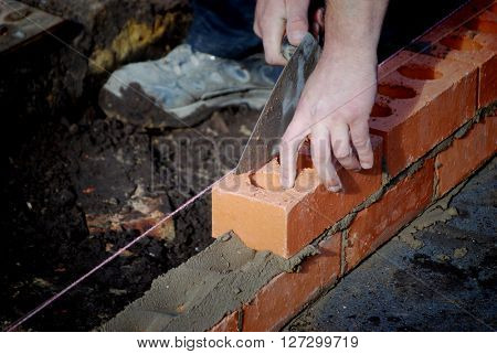 Closeup of bricklayer during the building of a house extension.
