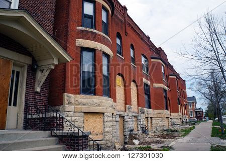 JOLIET, ILLINOIS / UNITED STATES - APRIL 19, 2015: The historic Swinbank Terrace, built in 1890 as Romanesque-style row housing, sits abandoned on Hickory Street in Joliet.