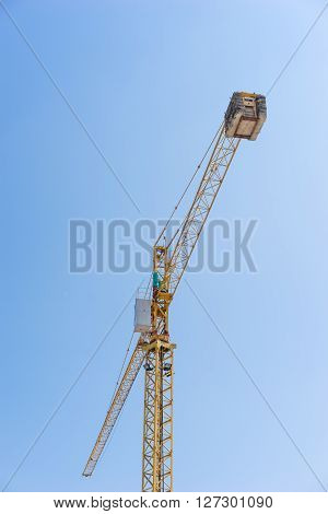the yellow Crane woking and Blue Sky