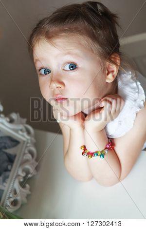 Beautiful small kid girl in studio .