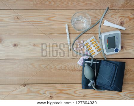 Water glass tonometer thermometer and medicaments on table