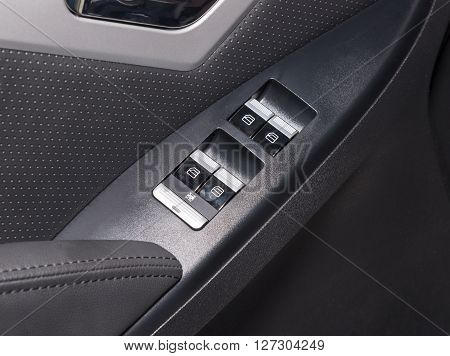Car door interior arm rest with window control panel