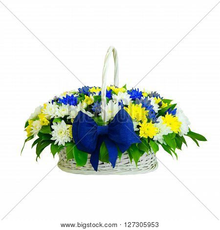 Wicker basket with delicate flowers on an isolated background.  Wicker basket with variety of delicate colors on an isolated background.