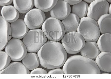 Handmade abstract background from white plasticine. You can overlay your image