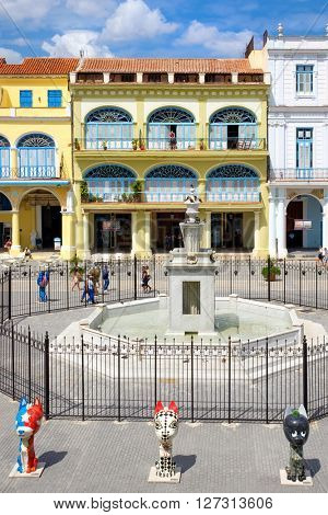 Colorful colonial architecture at Plaza Vieja in Old Havana