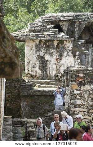 Tourists At Ancient Mayan City In Palenque Mexico