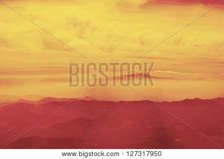 Aerial view of red mountain valley landscape panoramic scenery with sunset sky.