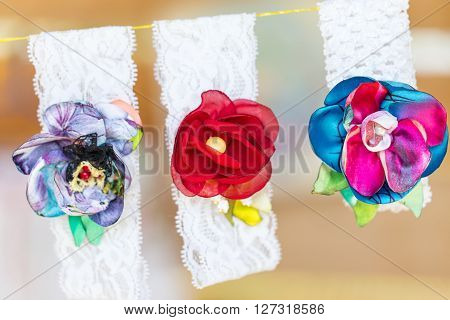Beautiful handmade textile brooches from artificial flowers. Macro shot. ** Note: Shallow depth of field