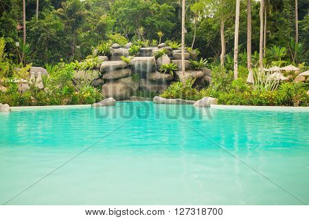 Jungle landscape with wonderful blue lagoon and flowing turquoise water cascade waterfall at deep tropical rain forest Thailand
