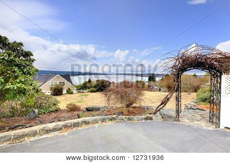 Yard And Drive Way With Burned Grass And Water View