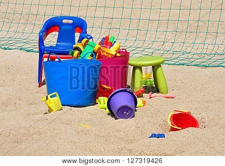 Detailed view of the plastic colored toys in the sandbox