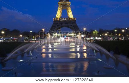 PARIS, FRANCE- MARCH 25, 2016: Eiffel tower illuminated with colors of the Belgian national flag to honor to victims of terrorist's attack in Brussels.
