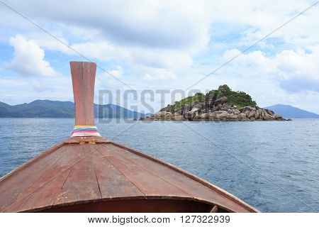view from nose of long tail boat in a sea to see islands desination way