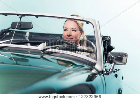 Smiling Retro 1960S Woman In Sports Car.