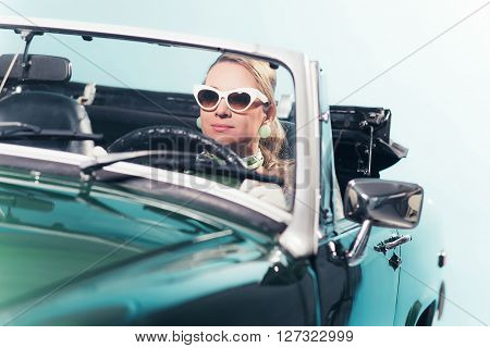 Vintage 60S Fashion Woman With Shades Driving Sports Car.