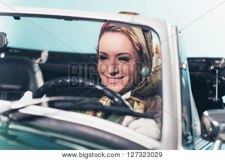 Smiling Retro 1960S Fashion Woman With Headscarf Driving Sports Car.