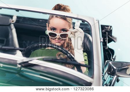 Vintage 1960 Woman In Convertible Car Looking Over Sunglasses.