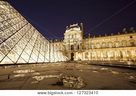 PARIS, FRANCE - MARCH 27, 2016: Louvre museum at twilight in spring. Louvre museum is one of the largest and most visited museums worldwide.