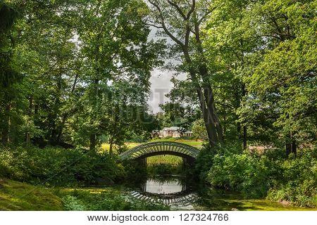 Manor house and bridge in Mon Repos Park. Vyborg Russia.