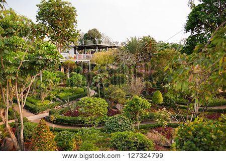 Nong Nooch Tropical Garden in Pattaya Thailand. Panorama landscape view of formal garden.