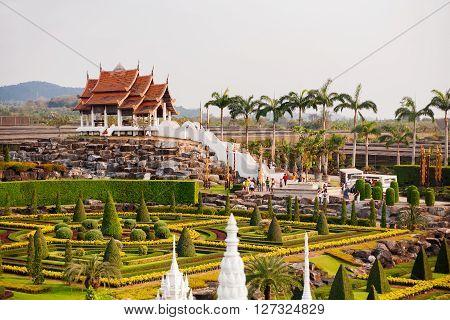 PATTAYA THAILAND - February 05 2011. Tourists walk in Nong Nooch Tropical Garden in Pattaya Thailand.