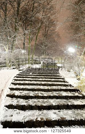 Snowcovered stairs in Riga park by night