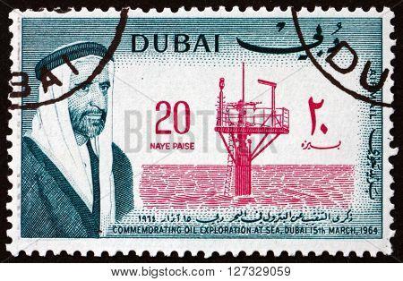 DUBAI - CIRCA 1964: a stamp printed in the Dubai dedicated to Oil Exploration at Sea circa 1964