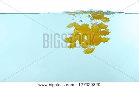 Gnocchi pasta falling in water