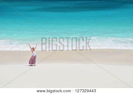 Girl on the desrt beach of Little Exuma, Bahamas