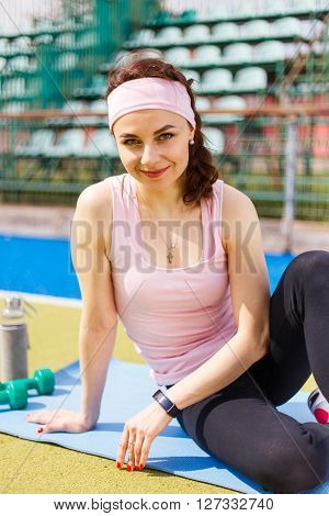 Young Happy Woman Rest After Training On Stadium