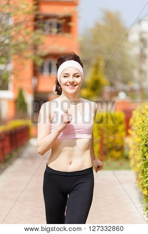 Young Happy Woman Jogging In The Street