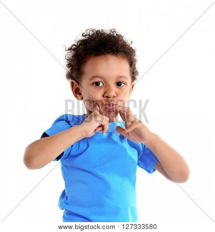 Little boy in blue shirt isolated on white background