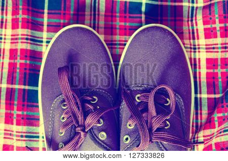 a pair of a purple trendy sneakers