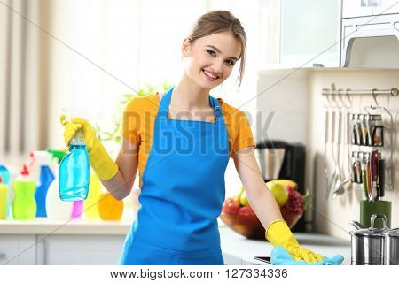 Cleaning concept. Woman washes an oven in the kitchen