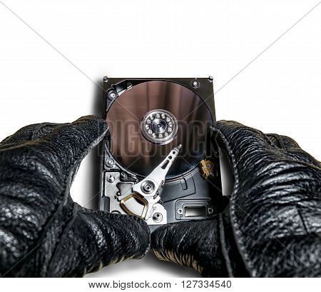 the hard drive from the computer in the hands in gloves isolated on white background