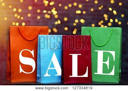 Word sale made with paper bags on lights background