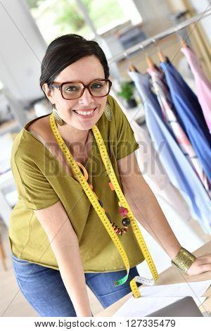Portrait of cheerful trendy fashion designer