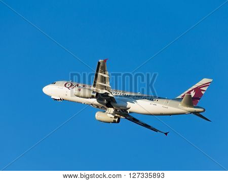Moscow - August 6 2015: Big airbas A320-232 Qatar Airways passenger plane landing in Domodedovo airport and on a background of blue sky August 6 2015 Moscow Russia