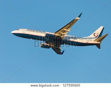 Moscow - August 20 2015: A passenger plane Boeing 737-86N Orenair flies to Domodedovo airport and the blue sky August 20 2015 Moscow Russia