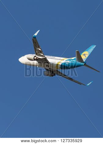 Moscow - August 20 2015: Large passenger plane Boeing A319 airlines Ukraine International Airlines flies to Domodedovo airport and the blue sky August 20 2015 Moscow Russia