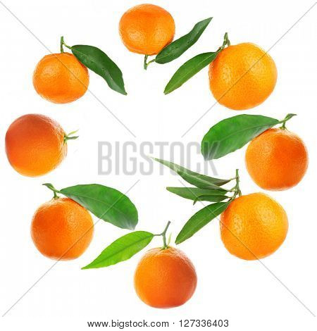 Round frame made of tangerines isolated on white